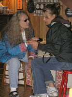 Nancy King and Ingrid Jensen engaged in girl talk at the annual Centrum faculty party.